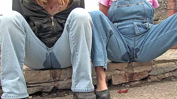2 girls pissing in overalls